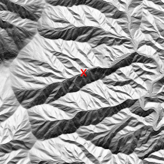 A series of ridges with hillshade from a sun coming from the bottom of the image.