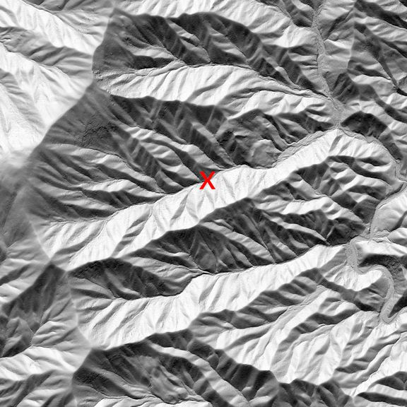A series of ridges with hillshade from a sun coming from the top of the image.